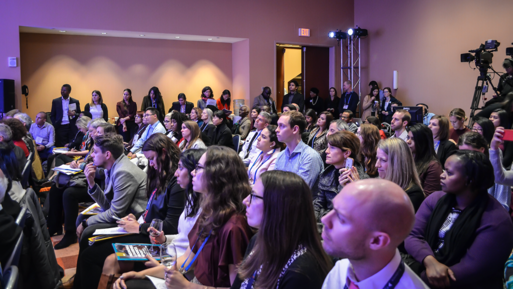 As the event began, the room was full of eager audience members .and more than 1000 others participated virtually.