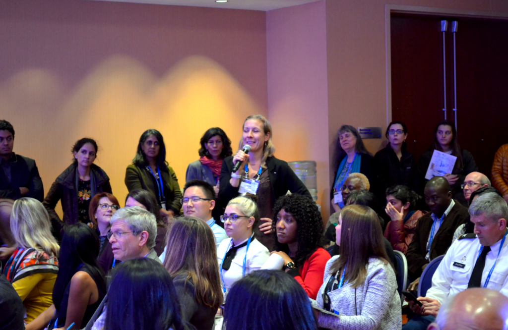 An audience members asks a question during the discussion with attendees.