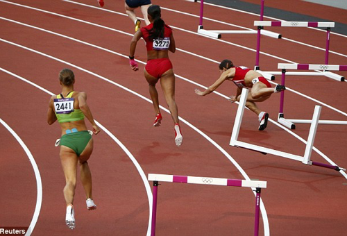 Olympic athlete falls over hurdle